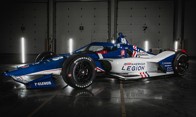 Indy Car Drivers Jimmie Johnson and Tony Kanaan pose with The American Legion 48 Car at the Team Ganassi Garage in Indianapolis, Ind., on Tuesday, April 6. Photo by Adam Pintar/The American Legion