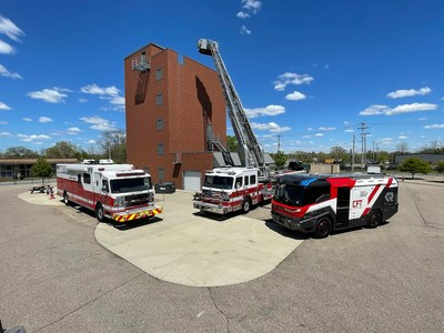 America's first electric fire truck on display (far right), alongside existing fire trucks, for firefighters across the midwest.