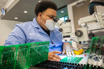 DeAndre Lurry, member of the inaugural graduating class of the Bachelor of Applied Science degree in microelectronic manufacturing, gaining hands-on training.