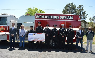OmniTRAX CEO Dean Piacente, VP Operations Kelli Dunn, President Sergio Sabatini and General Manager Brynn Moreland make community donation to Borger Fire Department Chief Bob Watson and crew.